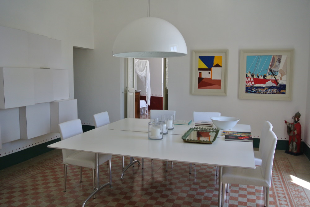Vico Magistretti design for De Padova, Franco Costa paintings in white frames. Pastoe wall furniture in white painted wood.